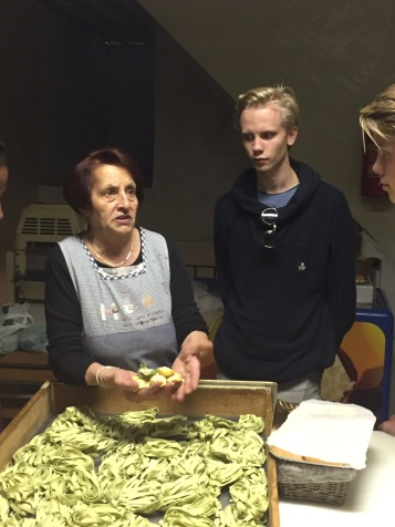 The lady showing her homemade pasta